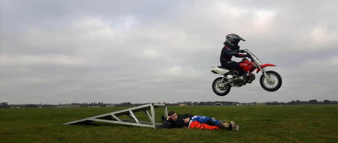 Jumping over Biker